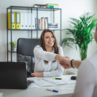 Young successful forewoman interviewing a job candidate at her office
